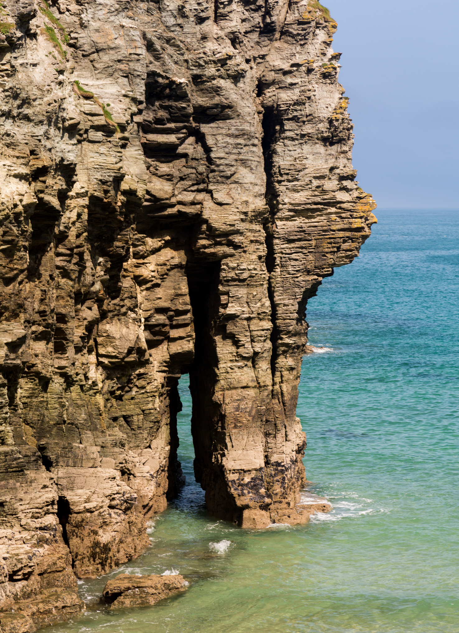 Sea Arch and cliffs jutting into the sea, Cornwall, England, UK