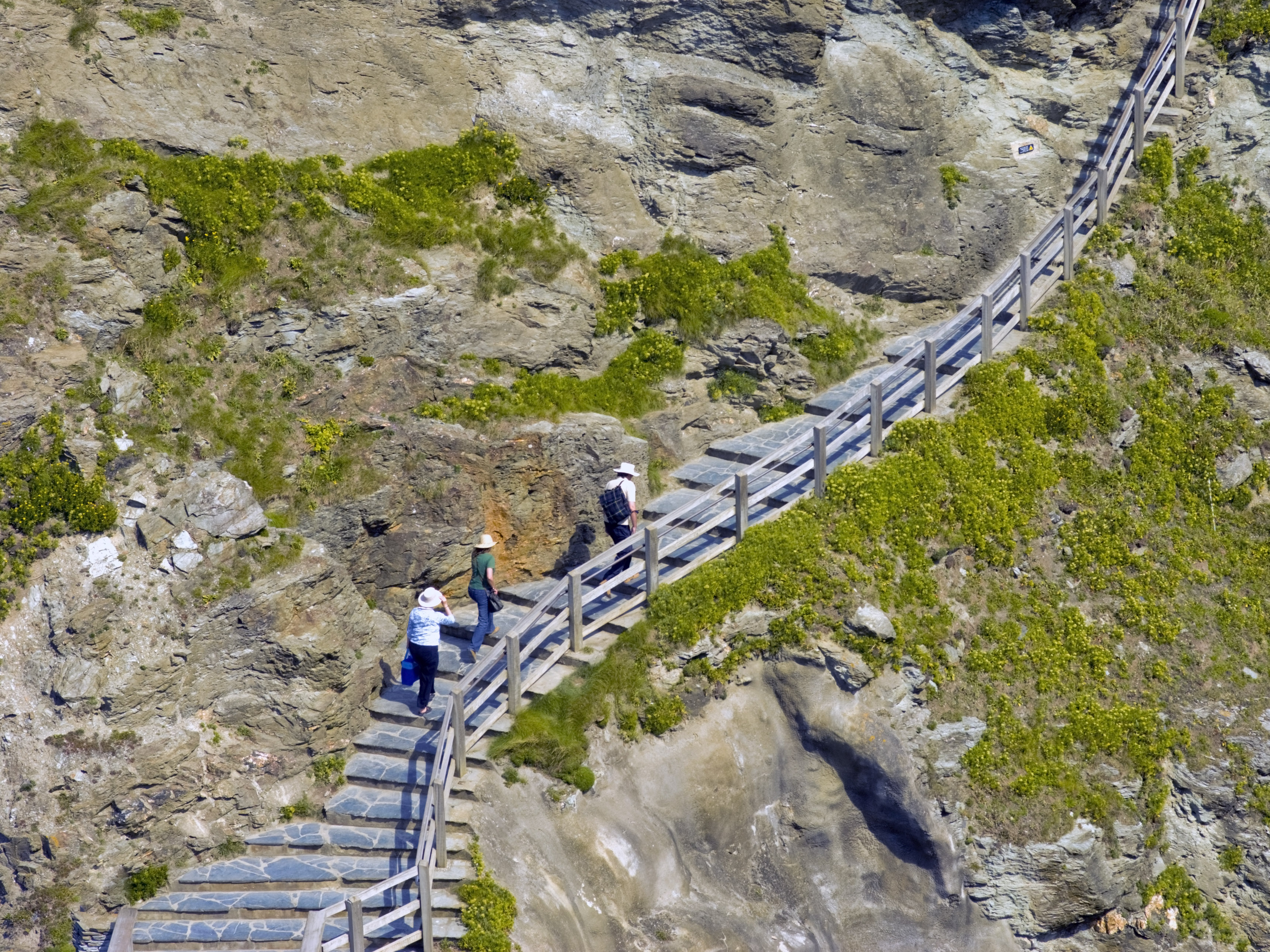 climbing the steps to tintagel castle the cornish coast cornwall england uk