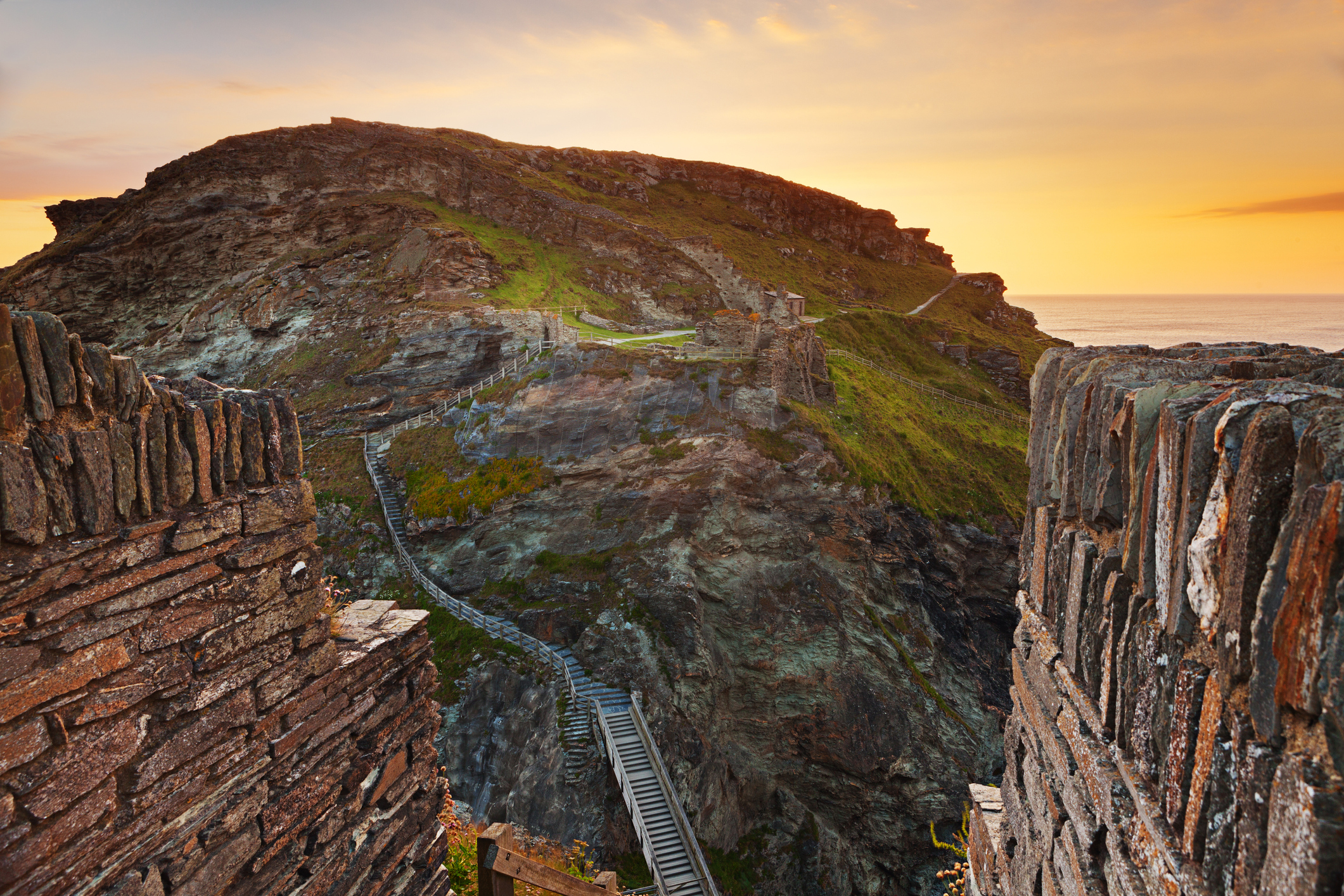 Rugged Tintagel with castle remains, Cornwall, landscape at sunset